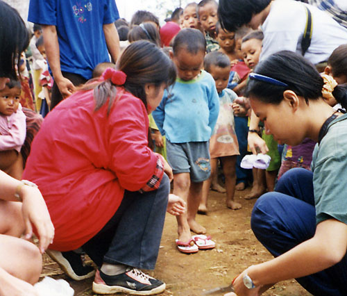 Giving Shoes to poor children